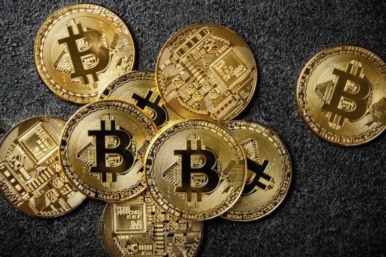 bitcoin-coins-on-black-background-P6W2KBT-768x512