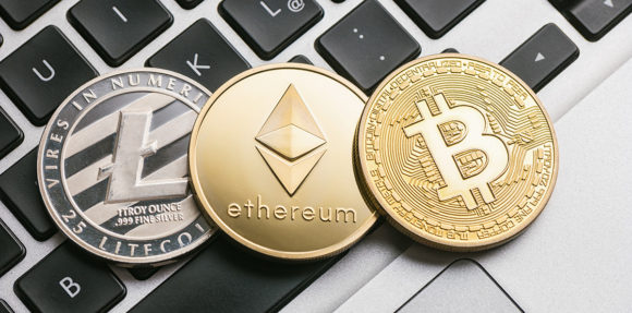 Digital cryptocurrencys Bitcoin, Ethereum, Litecoin on a noteboo