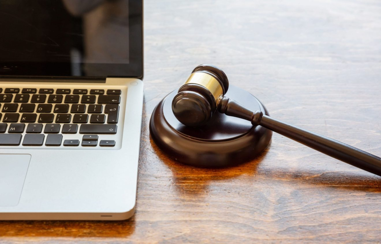 judge-gavel-and-a-laptop-wooden-background-online-RH5TA4Q-min-2-scaled